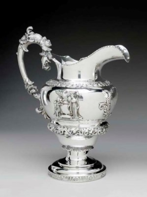 A SILVER WATER PITCHER OF CHIC
