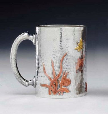 A SILVER AND MIXED-METAL CUP