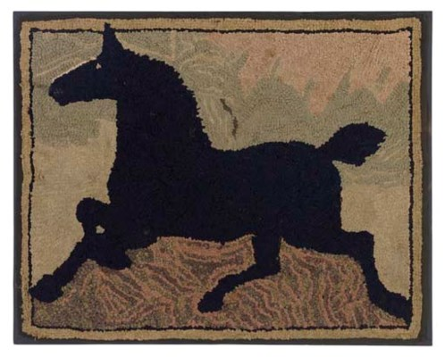 A COTTON AND WOOL HORSE HOOKED