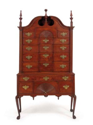 A CHIPPENDALE CARVED MAPLE BLO