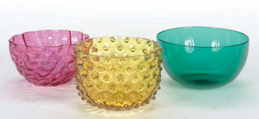 A GROUP OF COLORED GLASS BOWLS