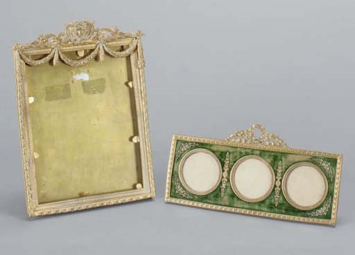 TWO GILT-METAL PHOTO FRAMES,