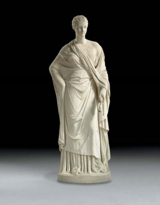 A WHITE MARBLE FIGURE OF A WOM