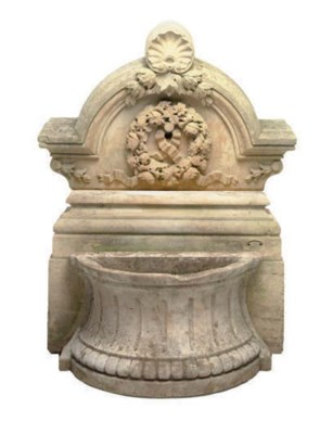 A CARVED STONE WALL MOUNTED FO