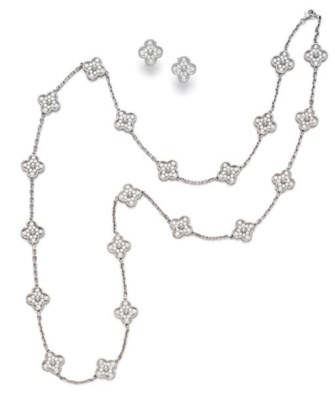 A SUITE OF DIAMOND AND WHITE G