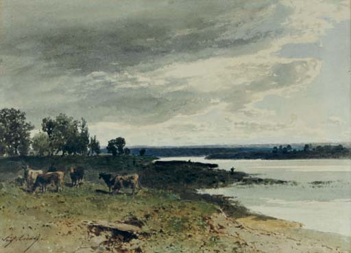 Cows grazing by a river