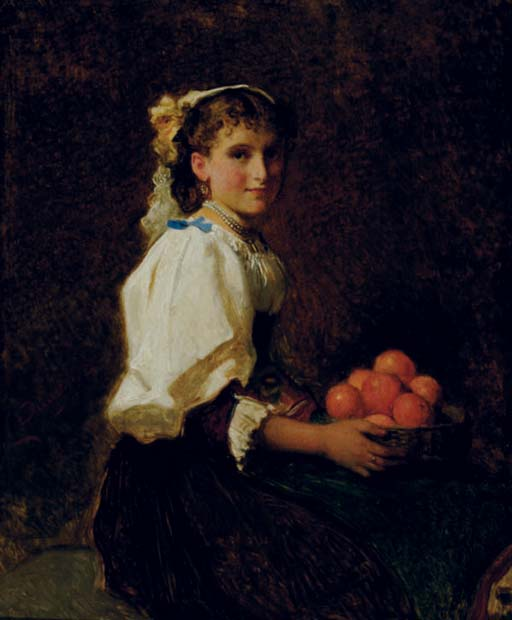 Seated girl holding oranges