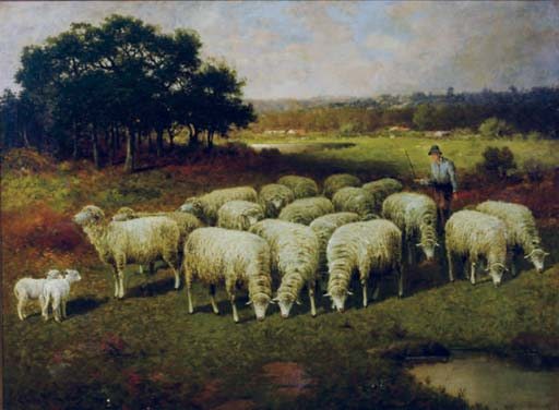 A shepherd with his sheep out in the field