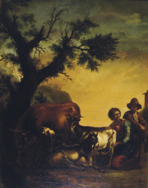 Shepherdess milking a goat by a tree with other farm animals nearby