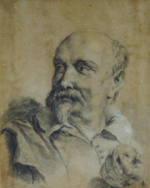A bearded man holding an apple