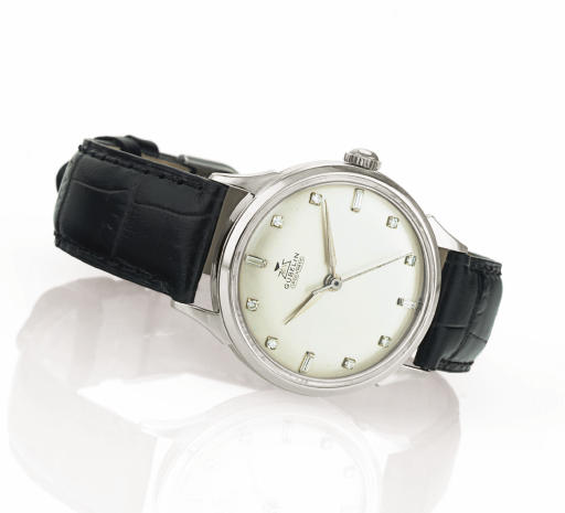 GÜBELIN.  AN 18K WHITE GOLD AND DIAMOND AUTOMATIC WRISTWATCH WITH CENTER SECONDS