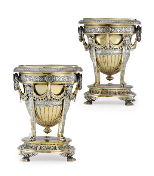 A FINE PAIR OF VICTORIAN PARCEL-GILT SILVER WINE COOLERS