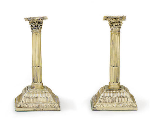 A PAIR OF GEORGE III SILVER-GILT SMALL CANDLESTICKS