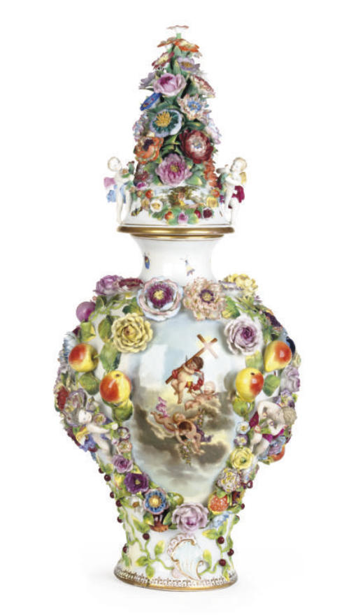 A GERMAN PORCELAIN FLOWER-ENCRUSTED VASE AND COVER,