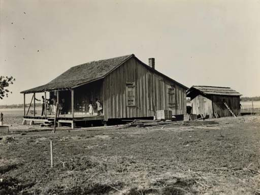 Family and Their Old Home, c. 1937; and Untitled (Store facades), 1936