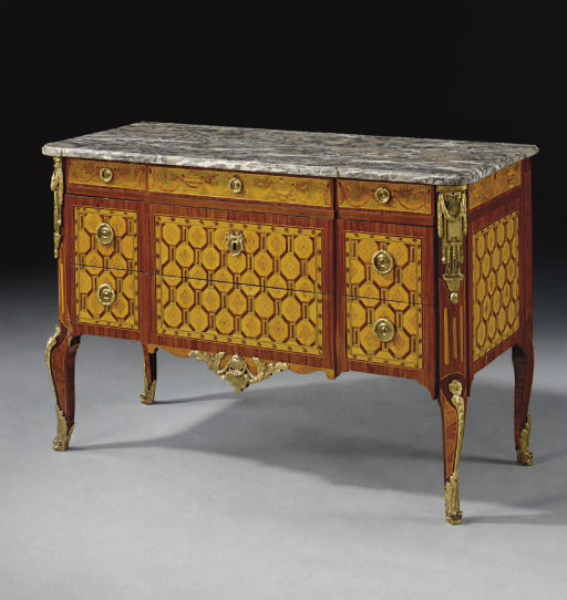 A LATE LOUIS XV ORMOLU-MOUNTED SYCAMORE, TULIPWOOD, AMARANTH AND GREEN-STAINED MARQUETRY COMMODE