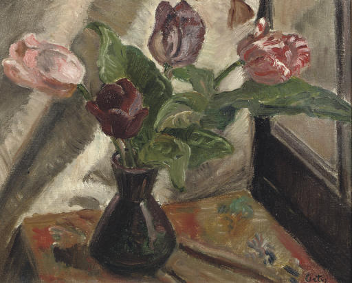 A still life with tulips in a vase