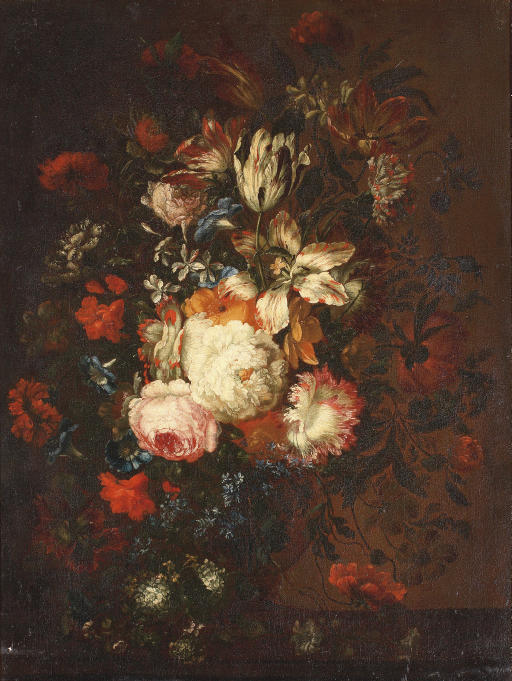 Roses, tulips, violets and other flowers in a glass vase on a wooden ledge
