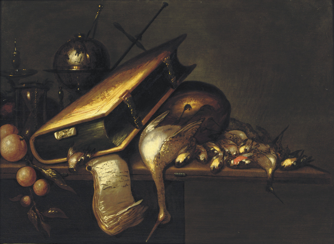 A 'vanitas' with a book, birds, oranges, a globe, a candlestick and an hourglass on a wooden table