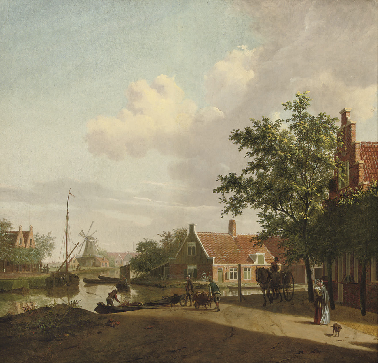 A town with figures working and conversing along a river, a windmill beyond