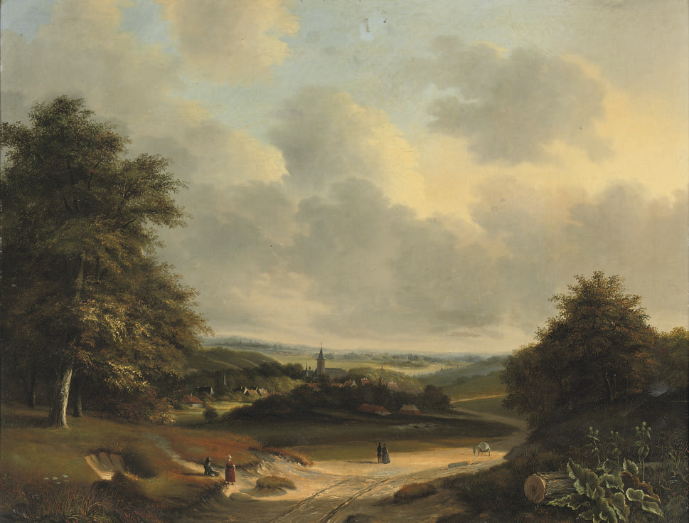 An extensive summerlandscape with a view of a small village