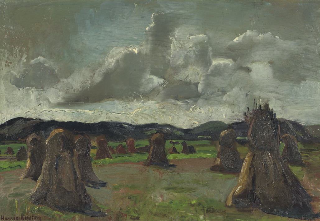 A field with haystacks
