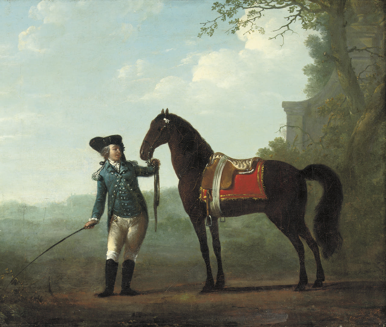 A rider with his horse in a landscape
