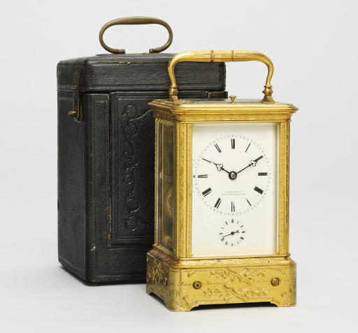 A French engraved gilt-brass striking and repeating eight day carriage clock with musical alarm