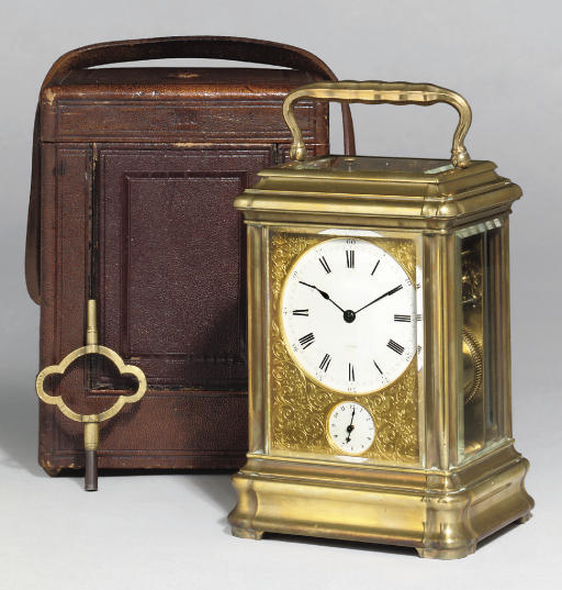 A French giant brass striking and repeating eight day carriage clock with alarm