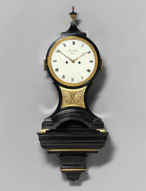 A George III ebonised and brass-mounted striking eight day bracket clock on wall bracket