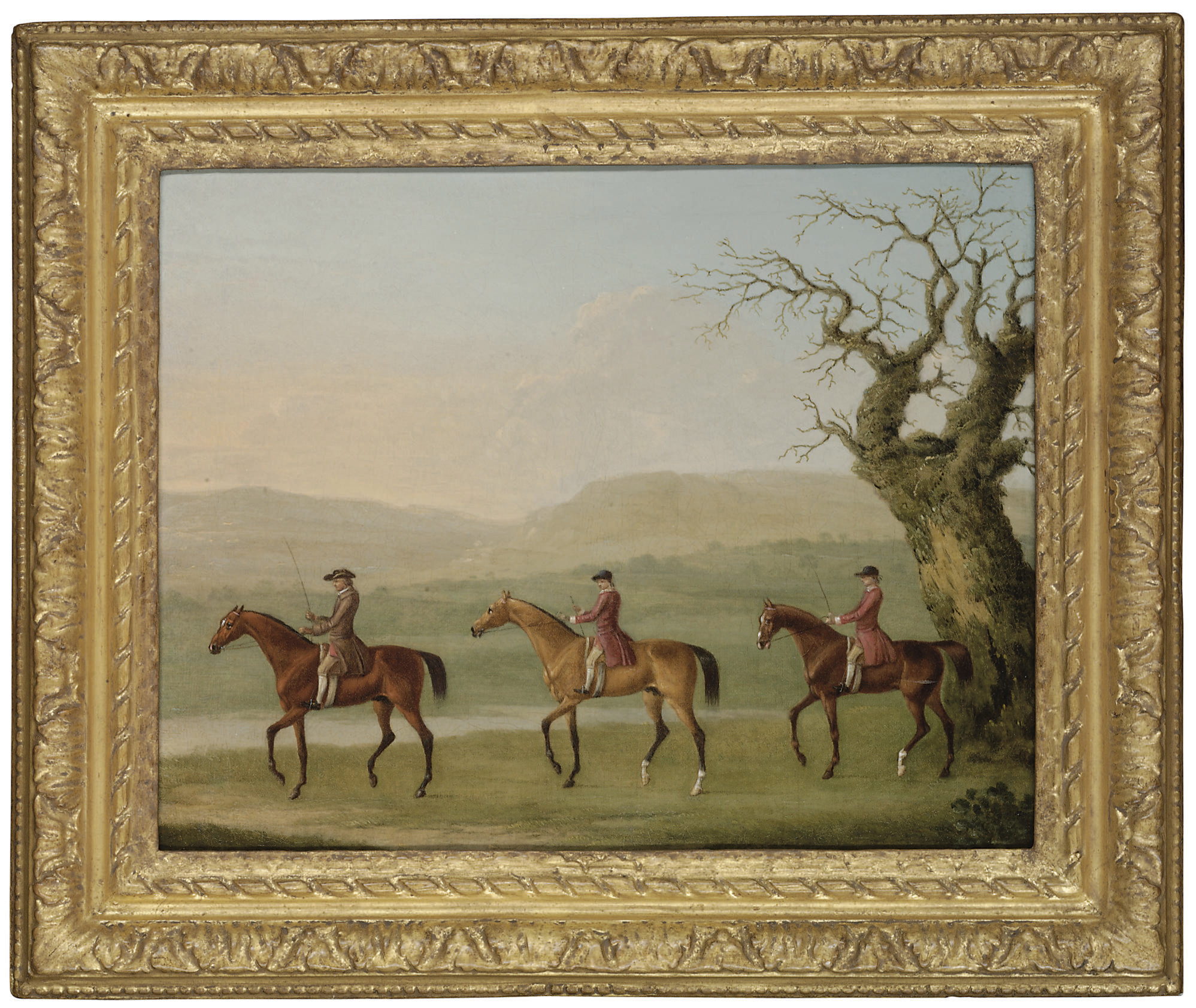 A trainer and two grooms exercising racehorses