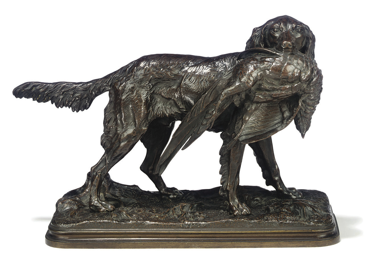 A FRENCH BRONZE GROUP OF AN IRISH SETTER HOLDING A PHEASANT