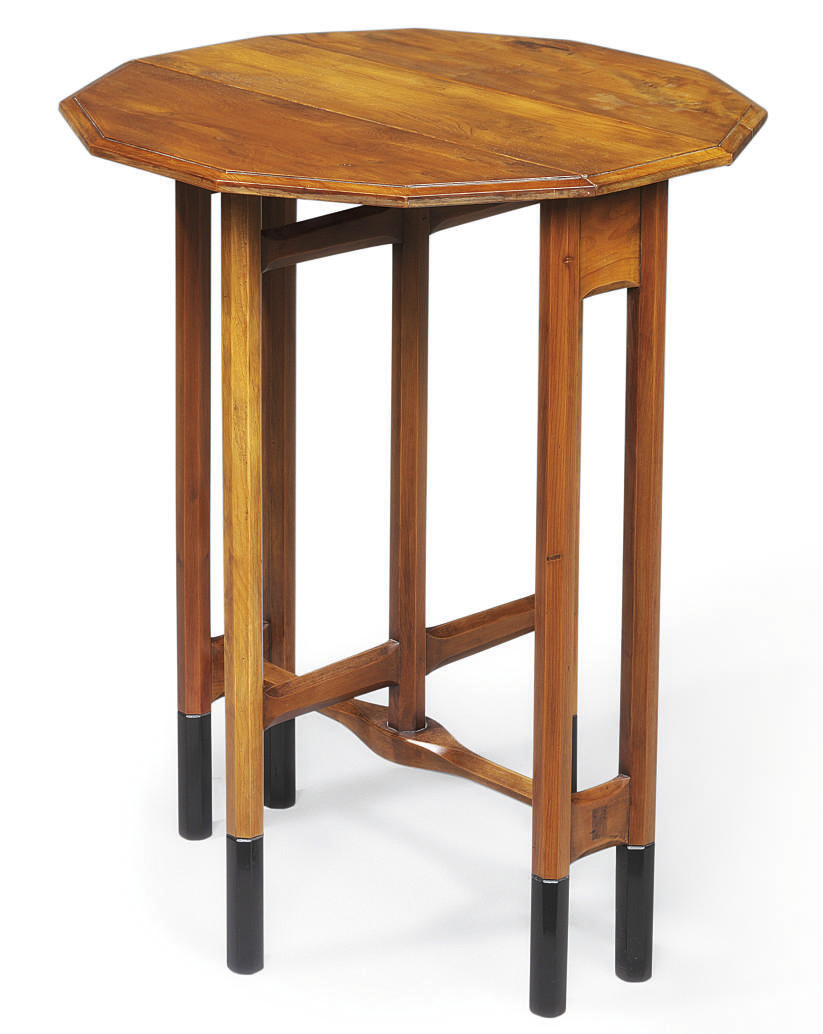 AN ARTS AND CRAFTS SOLID YEW AND EBONISED GATE-LEG TABLE