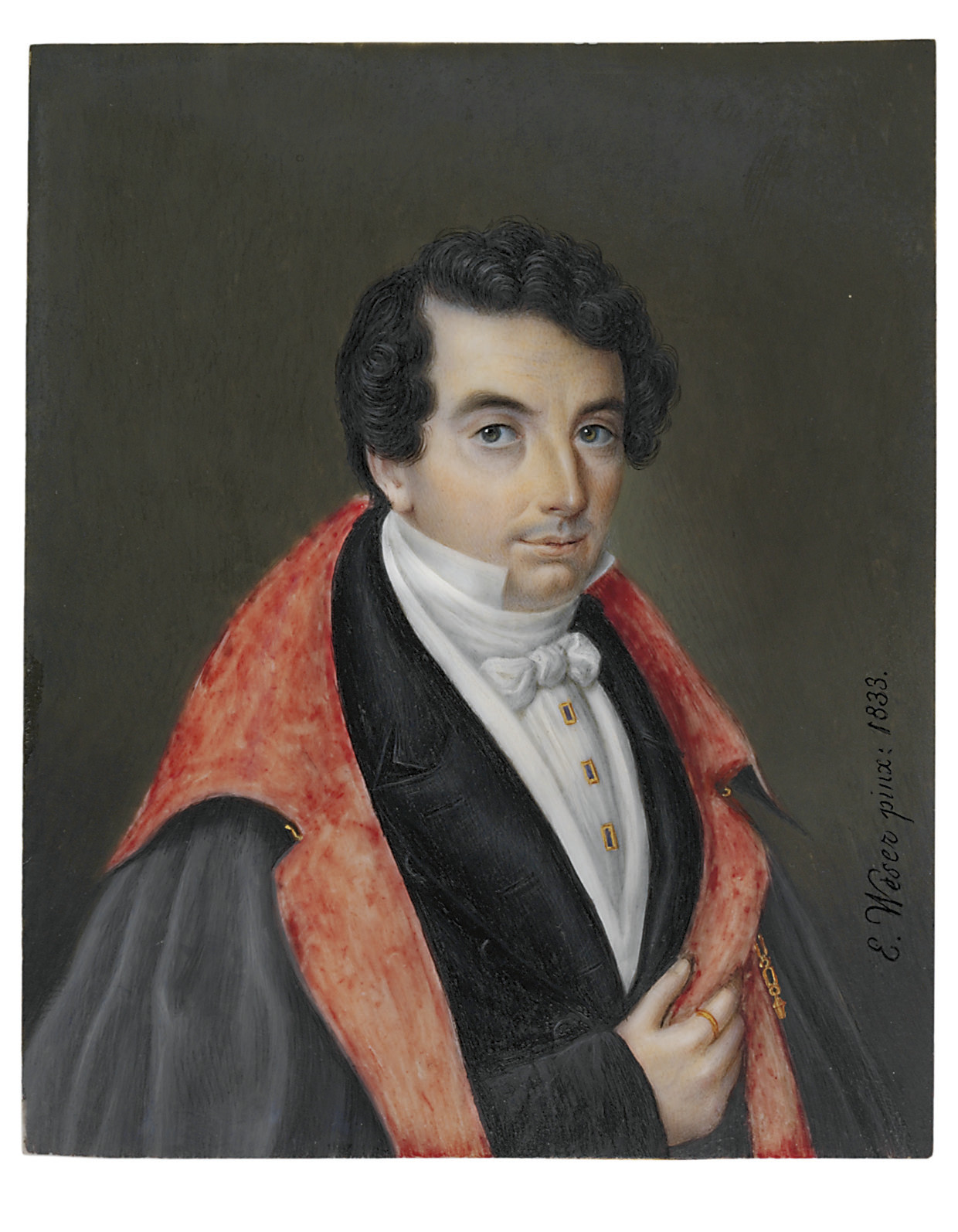 A young gentleman, in evening dress, black tail coat, white waistcoat, white linen shirt with stand-collar, white cravat tied in a bow, rectangular gold-bordered blue shirt studs, salmon-lined grey opera cloak with gold fastening chain, gold ring on his right index finger, side-parted short dark hair