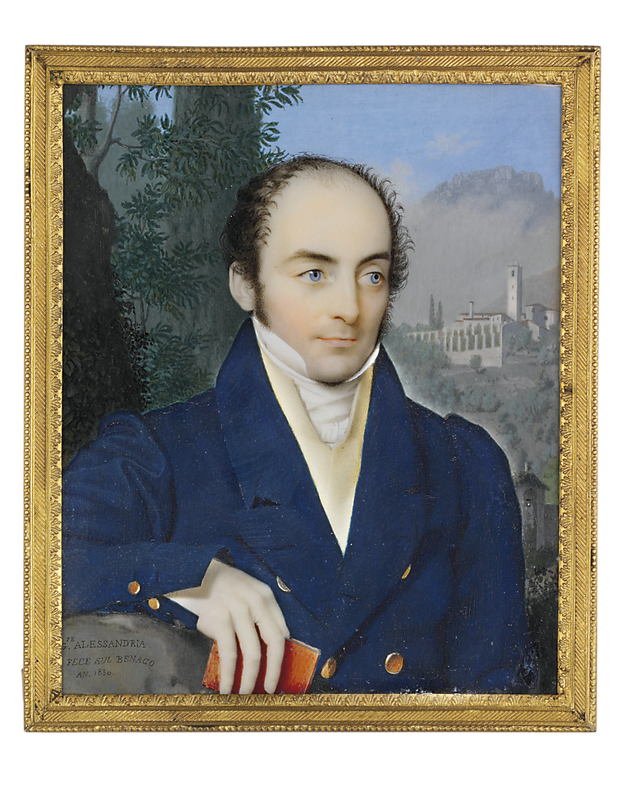 A gentleman, in Prussian blue coat, corn yellow waistcoat, white knotted cravat, holding a red book in his right hand; architectural and foliate mountainous landscape background