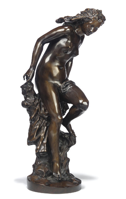 A FRENCH BRONZE FIGURE ENTITLED 'LA FRILEUSE'
