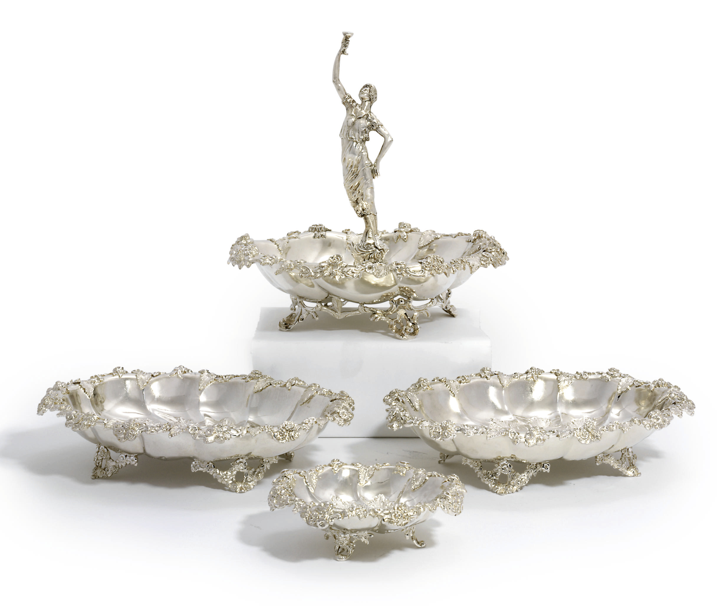 A SUITE OF FOUR VICTORIAN SILVER CENTREPIECE DISHES
