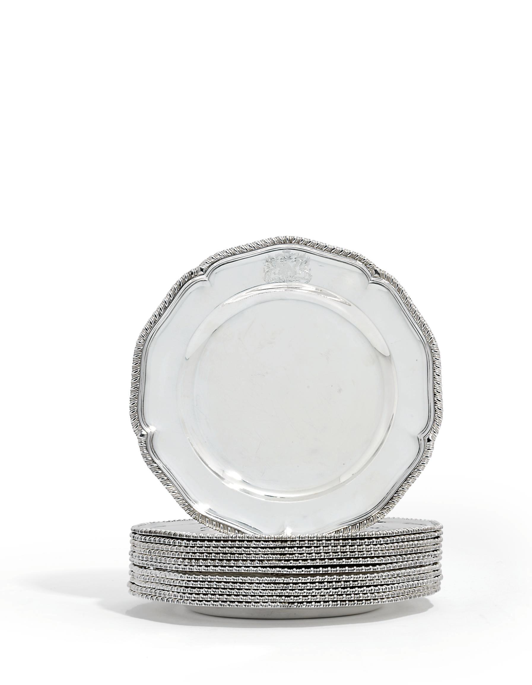A SET OF TWELVE GEORGE III SILVER DINNER-PLATES