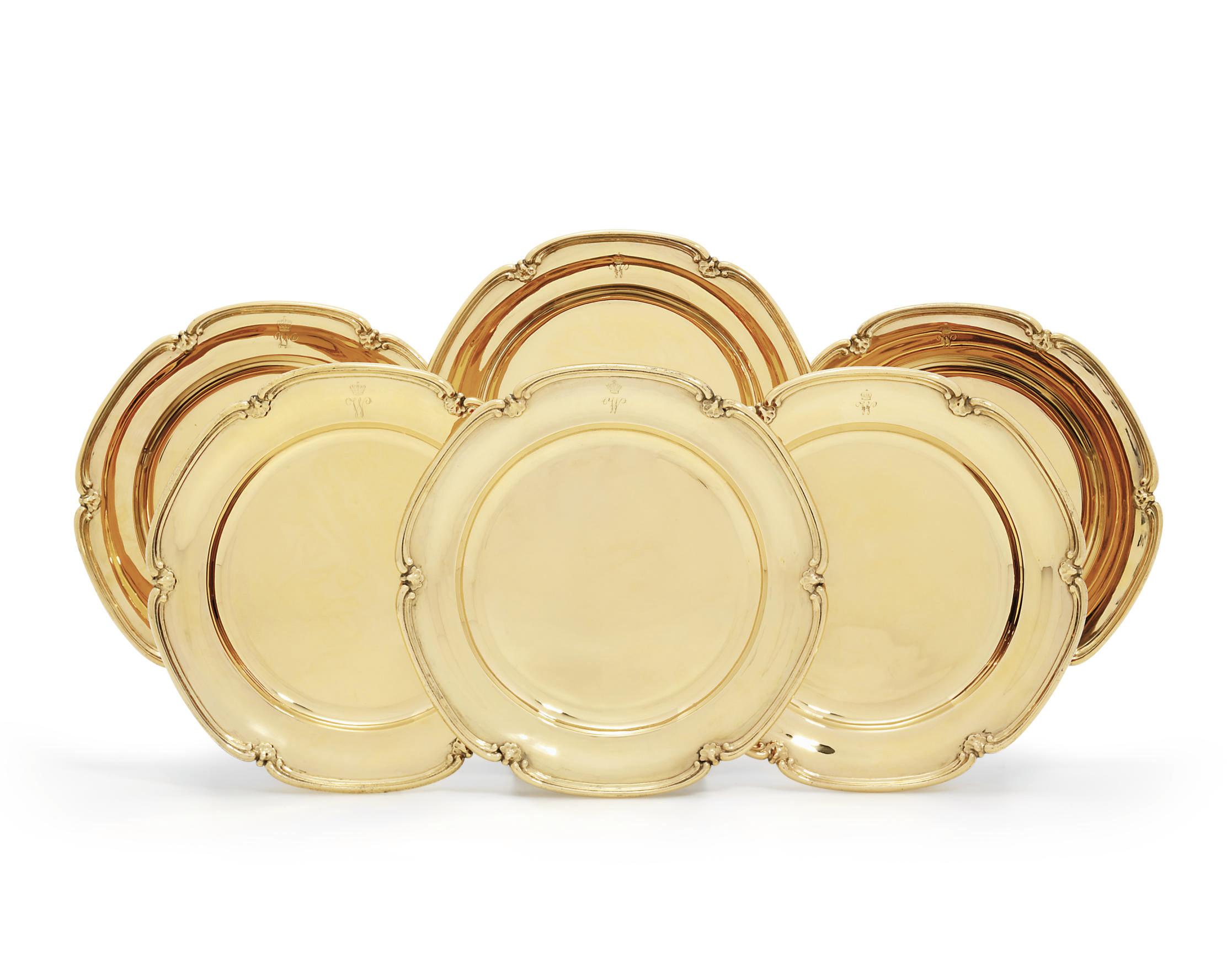 A SET OF SIX GERMAN SILVER-GILT DINNER-PLATES