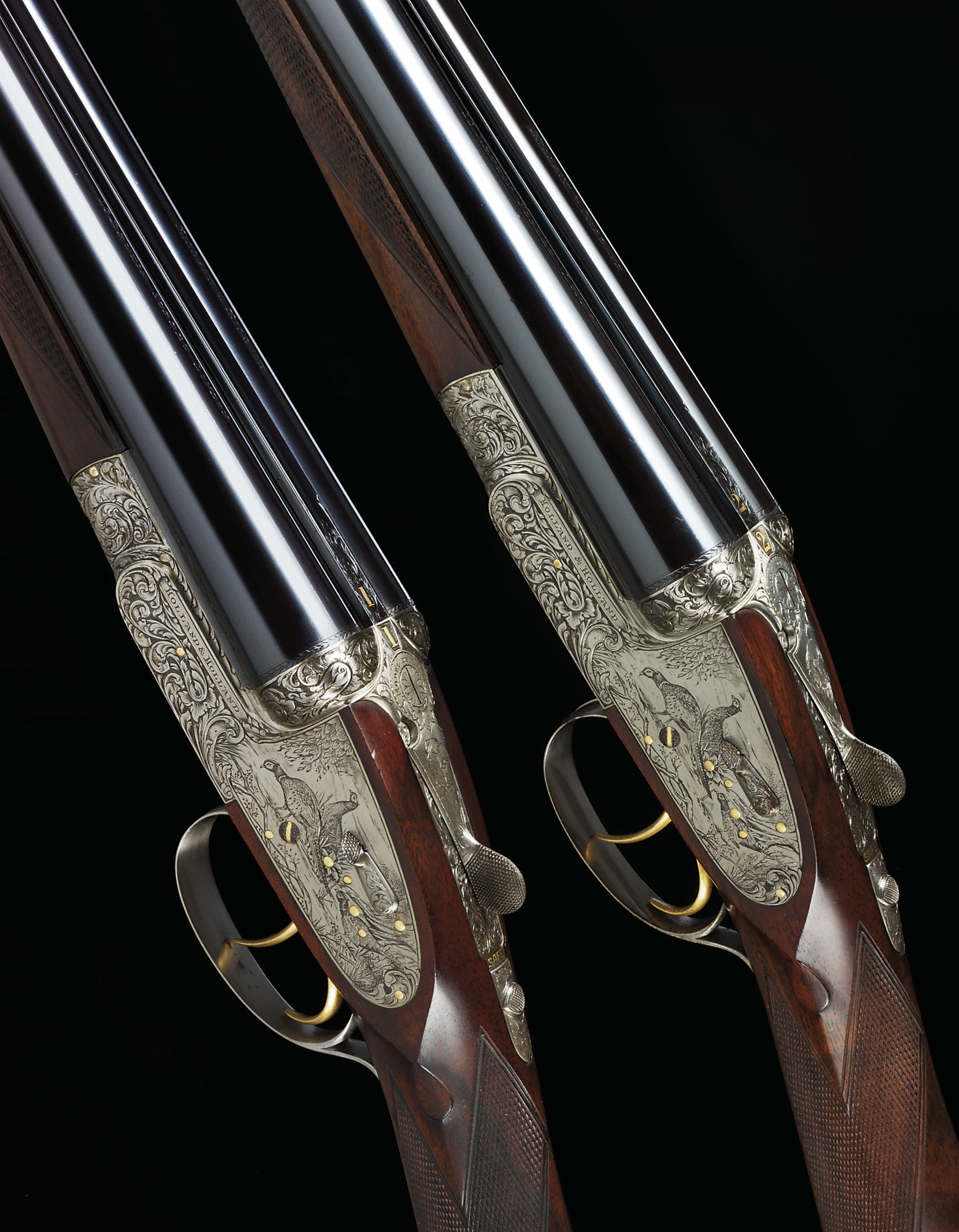 AN EXCEPTIONALLY FINE PAIR OF 12-BORE SELF-OPENING SIDELOCK EJECTOR GUNS BY HOLLAND & HOLLAND, NO. 40297/8