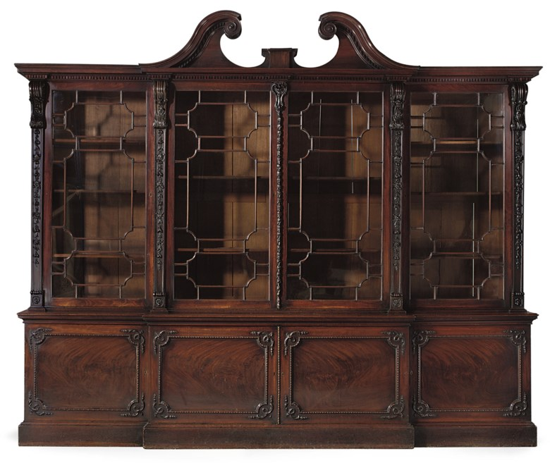 A George III mahogany breakfront bookcase, by Thomas Chippendale, 1764. 109½  in (278  cm) high; 133¾  in (340  cm) wide; 23  in (58.5  cm) deep. Sold for £2,057,250 on 18 June 2008  at Christie's in London