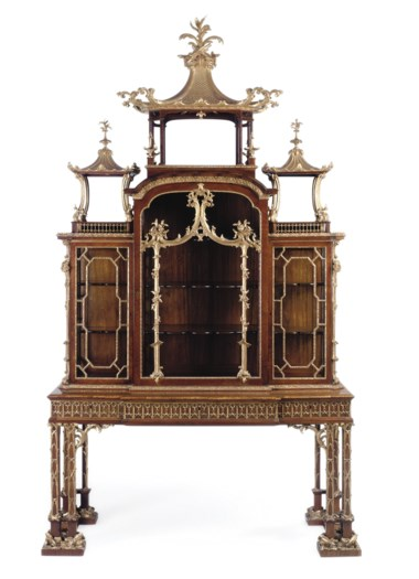 A George II parcel-gilt padouk cabinet-on-stand, attributed to Thomas Chippendale, 1755-1760. 111½  in (283.5  cm) high; 64½  in (163.5  cm) wide; 26¼  in (66.5  cm) deep. Sold for £2,729,250 on 18 June 2008  at Christie's in London