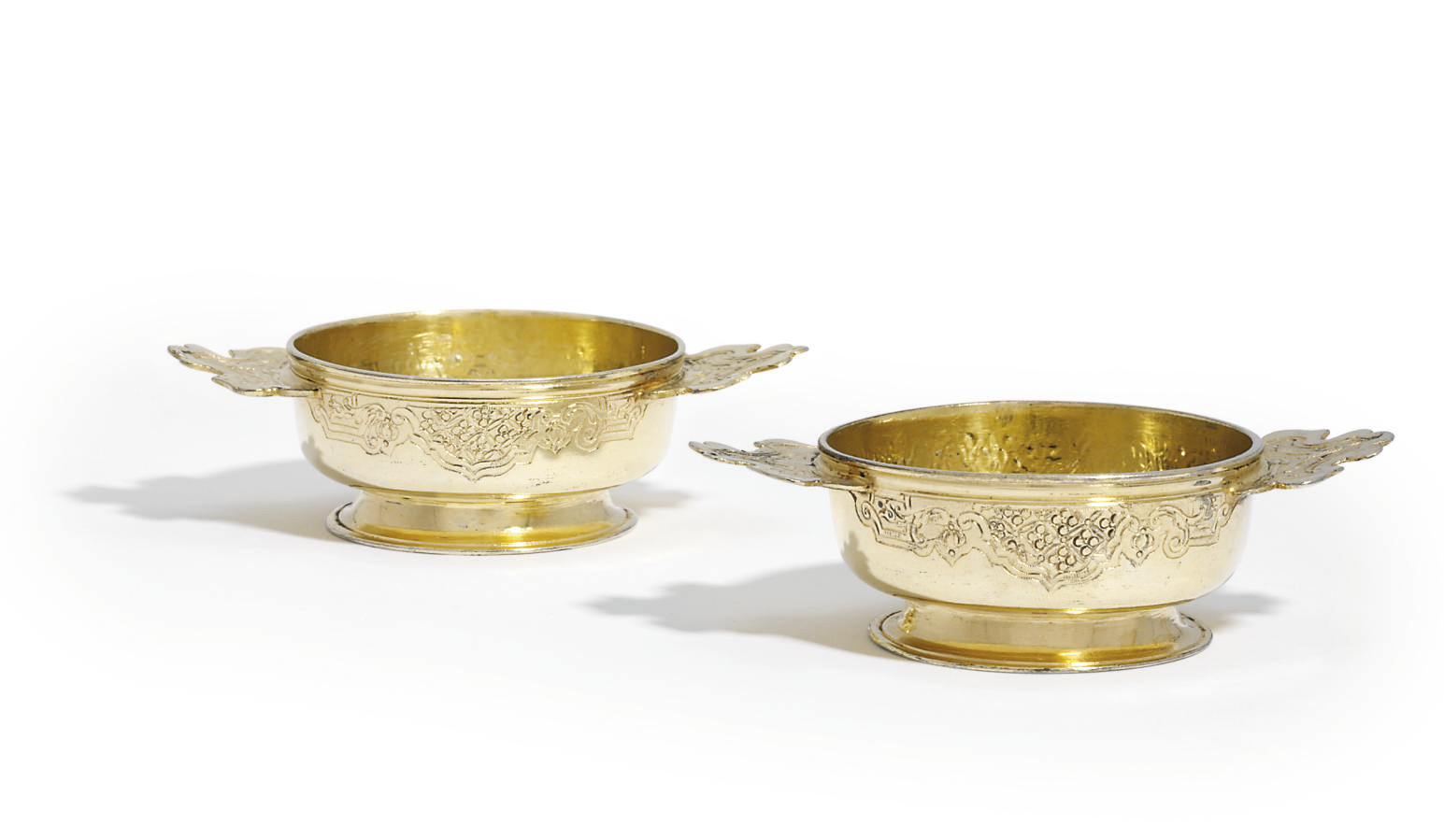 A PAIR OF GERMAN SILVER-GILT TWO-HANDLED BOWLS