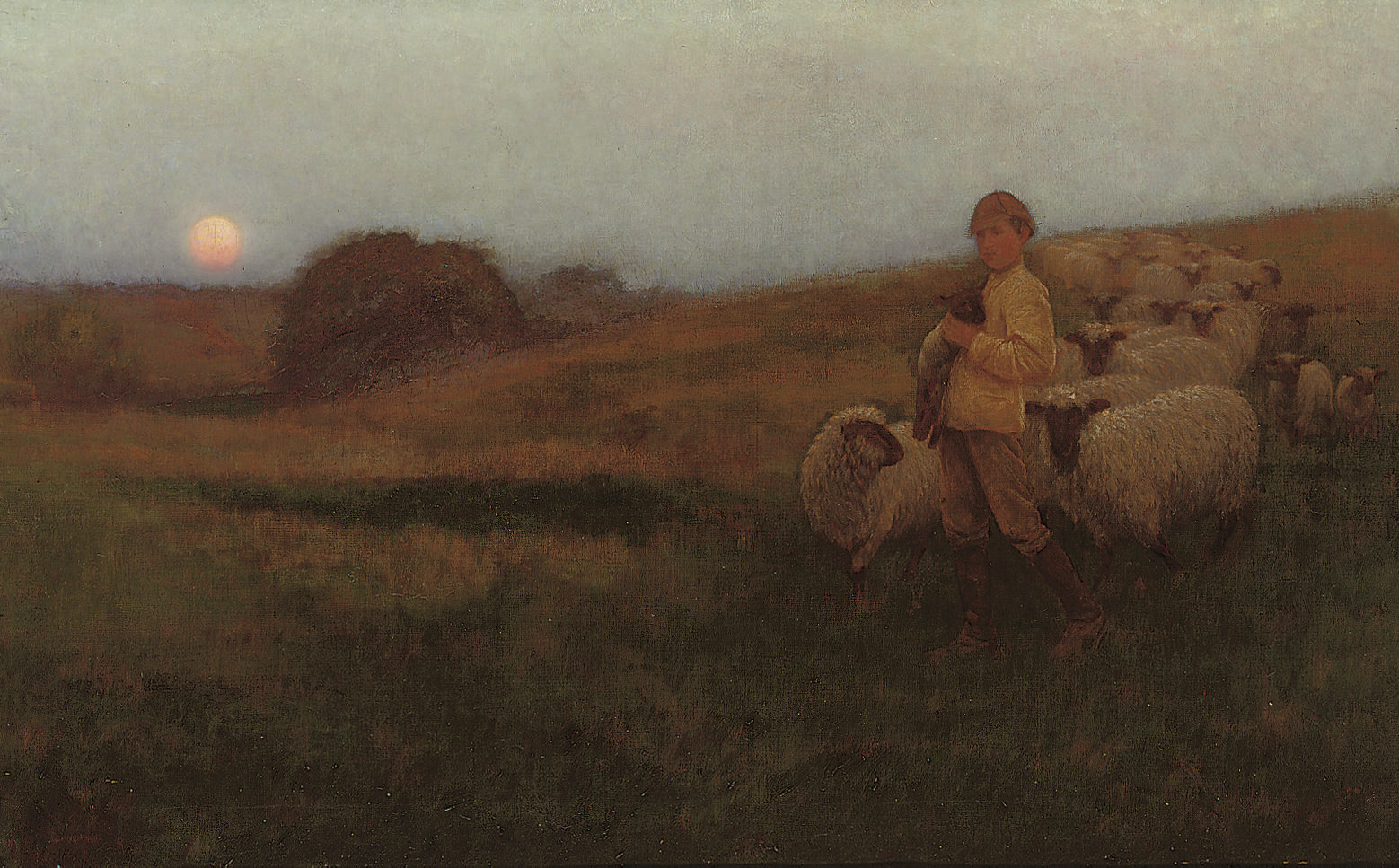 A shepherd boy and his flock at sunset