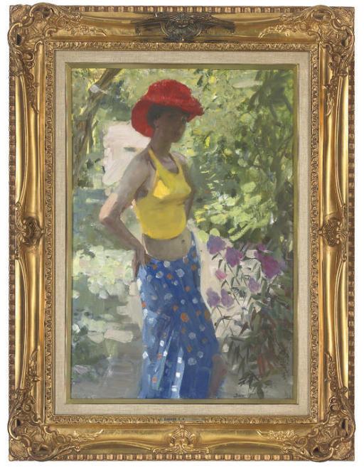 A young woman in a summer garden
