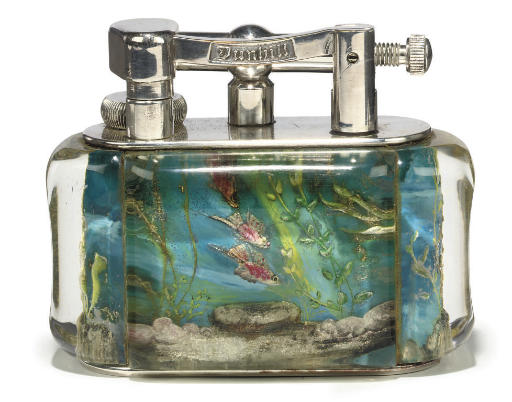 A CHROME MOUNTED PERSPEX 'AQUARIUM' TABLE LIGHTER