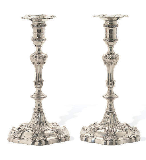 A MATCHING PAIR OF GEORGE III CAST SILVER CANDLESTICKS
