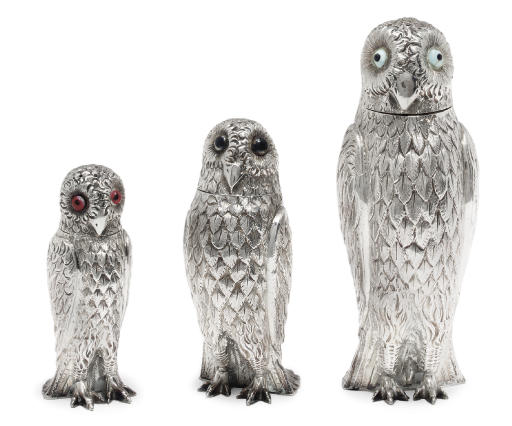 A GRADUATED SET OF THREE VICTORIAN SILVER OWL CONDIMENTS