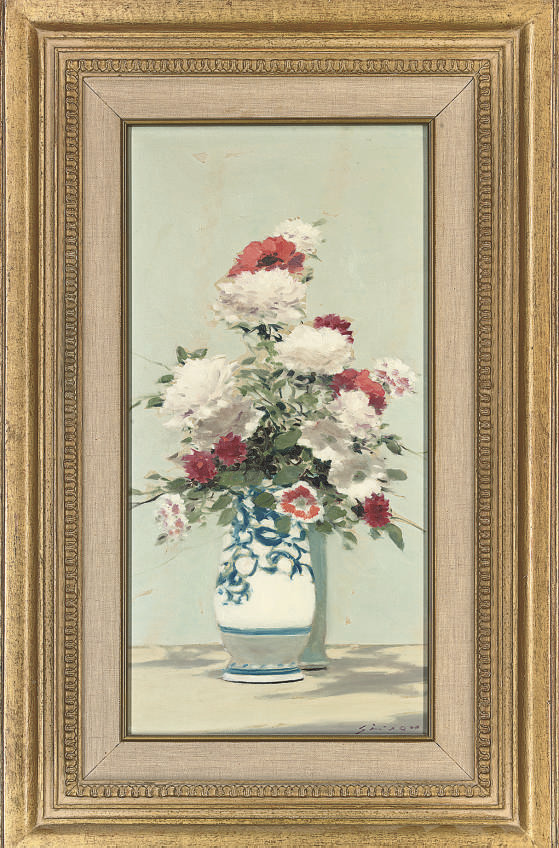 Carnations in a blue and white vase