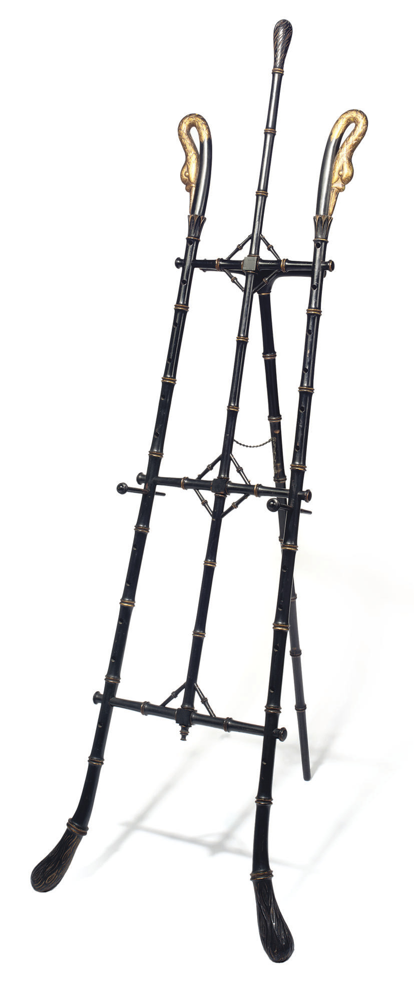 A LATE VICTORIAN EBONISED AND PARCEL-GILT EASEL